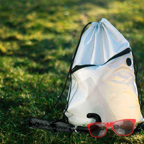 Bag, Umbrella and Sunglasses on Grass